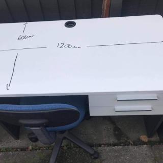 White desk. Needs repair.