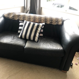 Black 2 seater couch - leather look
